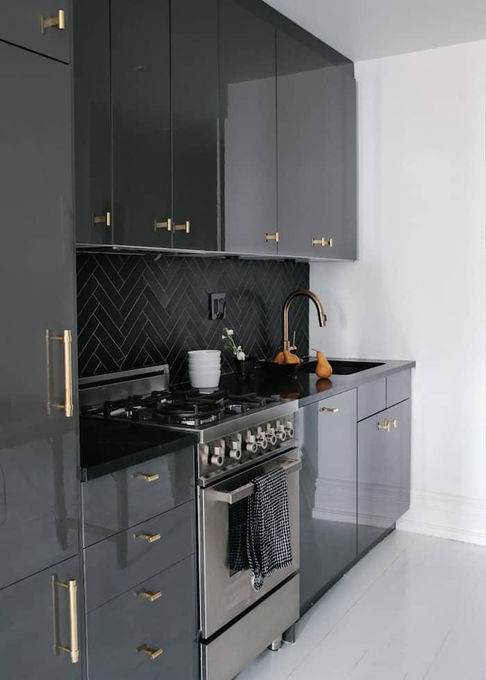 glossy-black-cabinets-bronze-hardware